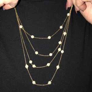 four chain gold necklace